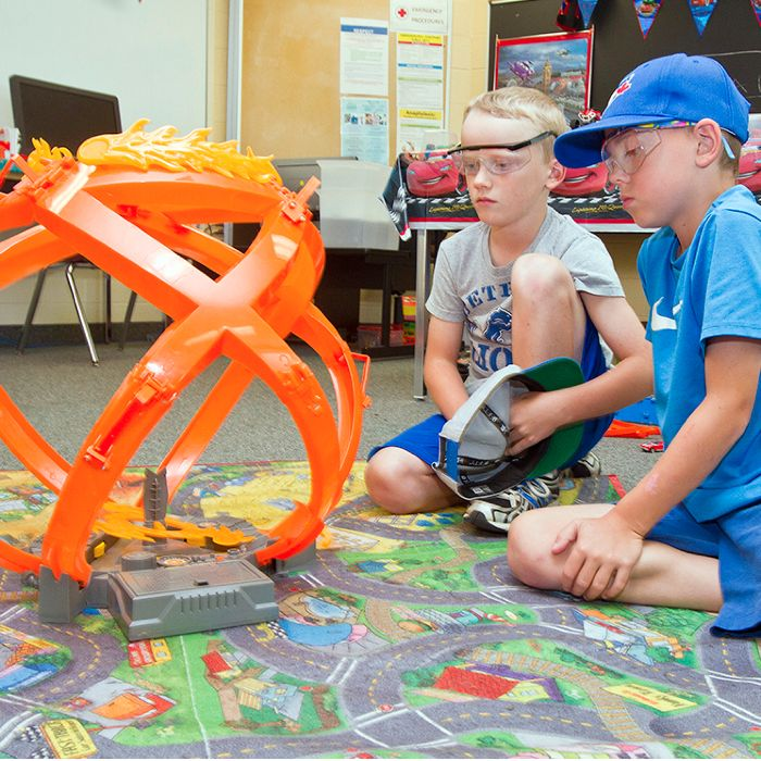 Ethan VanDerMeersch, left, and Charlie Tufford test out a toy car on the Fireball Hot Wheels track at their Fast Wheels Car Camp class July 12. The popular class is part of the Campus For Kids workshops at Chatham's St. Clair College campus.