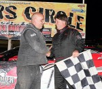 James MacDonald/South Buxton Raceway Ridgetown's Dale Glassford, right, shakes hands with second-place Mike Lewis of Wallaceburg.