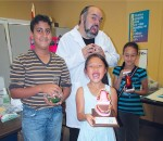 From left, Ali Baama, 12, Dorothy Li, 8 and Katerine Garcia, 8, hang out with Rob Tymec from Mad Science.