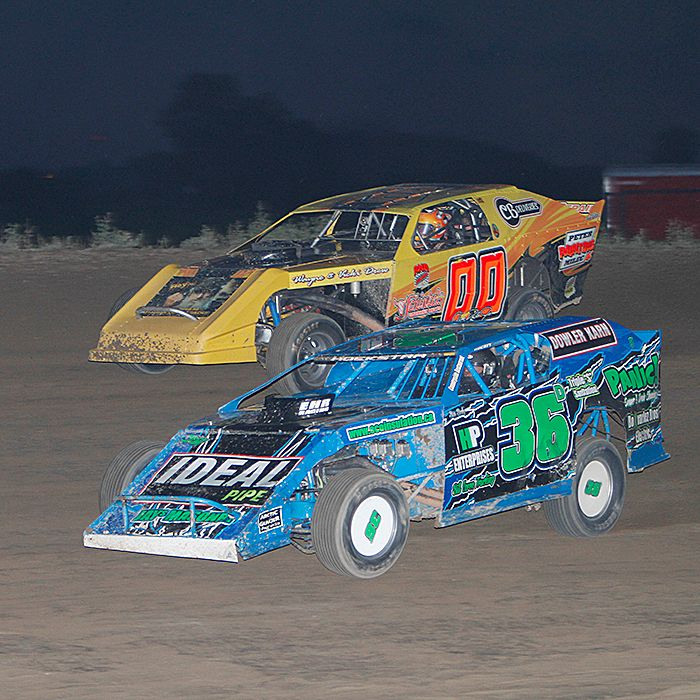 Darryl Hoekstra, foreground, and Jim Dale Jr. battle it out Saturday night at South Buxton Raceway.