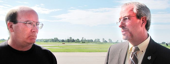 Jeff Pyefinch, representative of the Kinsmen Air Training Centre, has a heated discussion with Chatham-Kent Mayor Randy Hope over concerns a long-time gliding program is coming to an end at the C-K Municipal Airport.