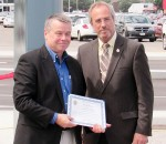 Dean Bradley, left, president of Brad-Lea Meadows, accepts congratulations from Chatham-Kent Mayor Randy Hope at the Thames Lea Plaza's grand re-opening Friday.