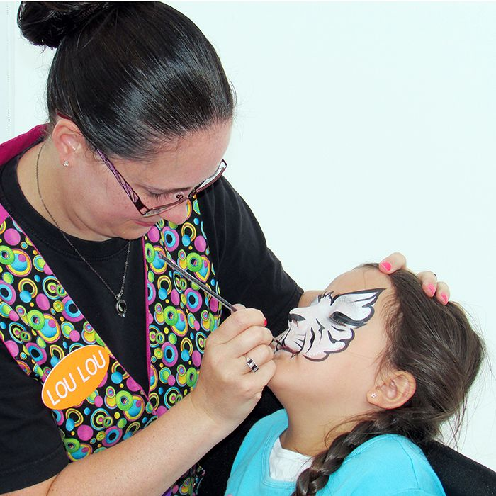 Corissa Almeida sits still as she gets her face painted Friday at the Thames Lea Plaza's grand re-opening.