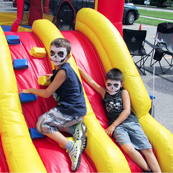 Evan Delany and Kalib Stonefish enjoy one of the inflatable castles in the Thames Lea Plaza Friday as part of the grand re-opening celebrations.