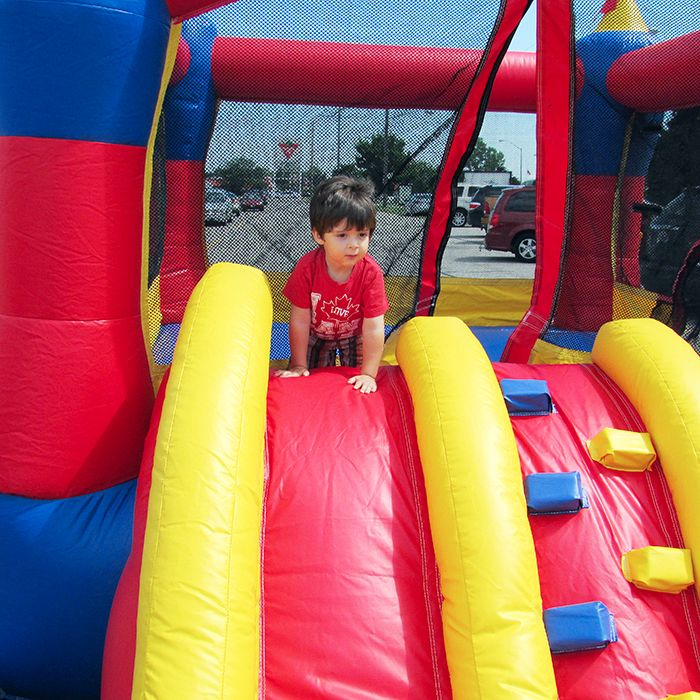 Jacob Chahbar looks out over his domain from one of the inflatable castles set up for Friday's grand re-opening of Thames Lea Plaza