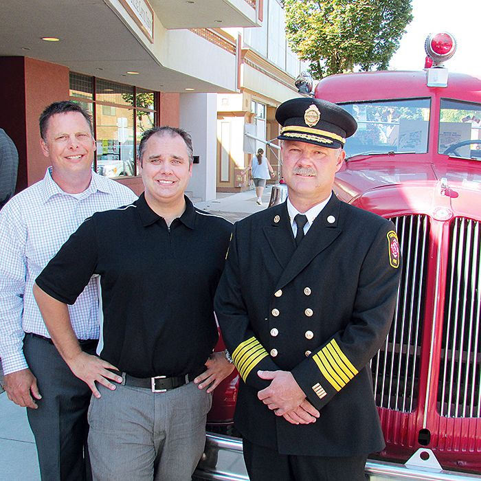 FireFest Chatham-Kent organizers Keith Chinnery, left, Brent DeNure and new Chatham-Kent Fire Chief Ken Stuebing stand in front of a Bickle Seagrave fire truck that served in Chatham until 1984. The truck, and dozens of others, will be on display at the second annual FireFest Sept. 21 in downtown Chatham.