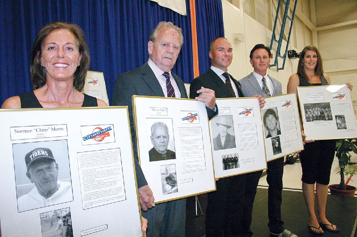 Elaine Morris, representing her late husband Norman, left; Martin Aarts; Peter Gilbert, on behalf of his late grandfather Peter; Tyson Parry; and Michelle Willemsen (Dehaan) co-captain of the 1992-1993 John McGregor girls' basketball team were all inducted into the Chatham Sports Hall of Fame Sept, 12.