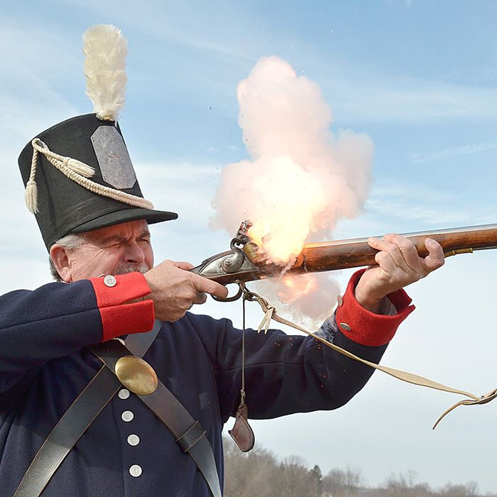 Dave Weldon, dressed as an American soldier from the War of 1812, opens fire. He and about 700 others will participate in the re-enactment of the Battle of the Thames on Oct. 5.