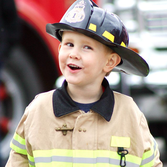 Ethan Cook, 4, from Chatham, checks out the fire trucks at the second annual FireFest in downtown Chatham.