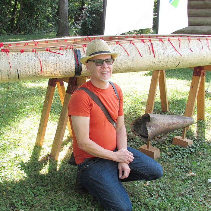 Artist Alex McKay showcases a treaty canoe, one of which will be part of the flotilla participating in the Battle of the Thames re-enactment.