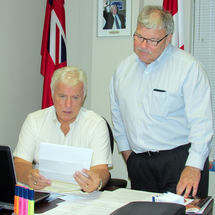 Chatham-Kent-Essex MPP Rick Nicholls and his executive assistant Larry Landry go over some correspondence from a constituent. Nicholls office was more than $60,000 under provincial standards.
