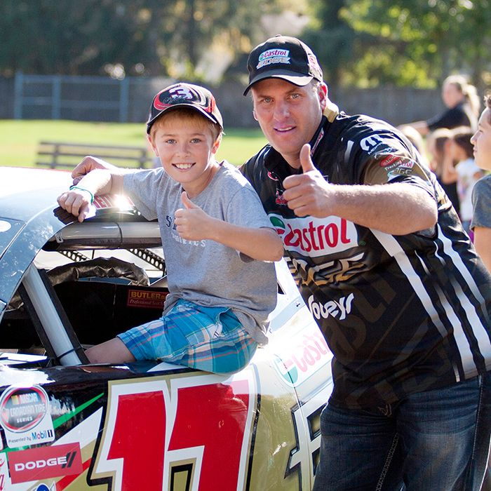 St. Ursula Catholic School Grade 6 student Zachary Dick gets a seat in D.J. Kennington's race car. His visit, sponsored by NASCAR and Sobeys, was a fundraiser for the school. Sarah Schofield photo.