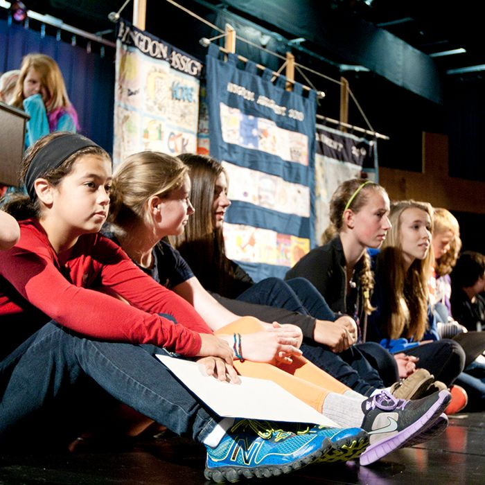 Students from 14 different grade schools line up along the stage at Ursuline College to receive $100 bills to raise money for the United Way of Chatham-Kent as part of the Kingdom Assignment. The kids are learning by example from scripture, to raise as much money as they can to help others in the community.