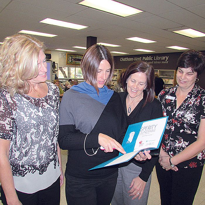 From left, Mary Lou Martin, Danielle Shaw, Donna Fraleigh and Tanya Sharpe, members of the Prosperity Roundtable, go over an information package at Tuesday's roundtable meeting at the Chatham library.