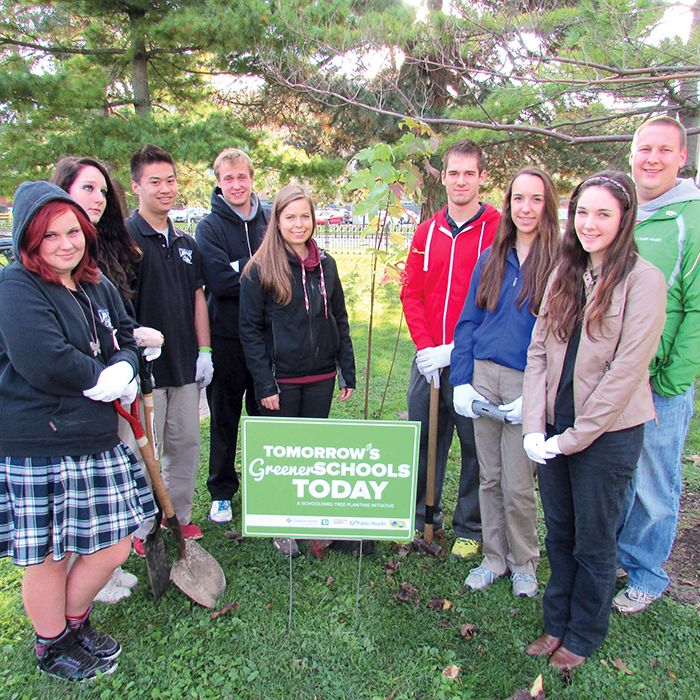 Ursuline College students from the Environmental Specialist High Skills program braved the cold to plant 10 red maple trees, a Carolinian native species, on the grounds of the high school with the help of Kelly Johnson from the Lower Thames Valley Conservation Authority, centre and Chatham-Kent Public Health Unit RN Dan Drouillard, right. The planting is part of the Tomorrow's Greener Schools…Today partnership thanks to a grant from TD Friends of the Environment Foundation.