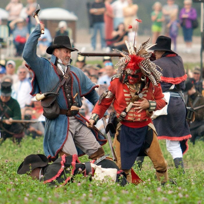 An American strikes the opposition during the Battle of The Thames reenactment on Saturday.