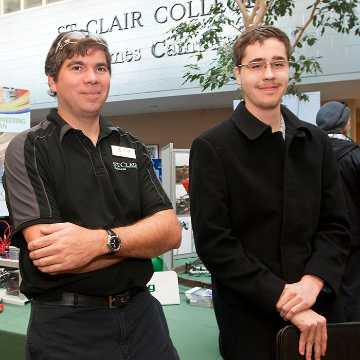 Electricity engineering technician and electricity techniques co-ordinator Ryan Pepper, left, gave prospective student Tom Somers an inside look into what the program would be like at this year's St. Clair College open house, held at the Thames Campus in Chatham on Nov. 23. Somers' biggest concern, like many other youth, is ensuring he will be able to find employment in his field after he graduates.