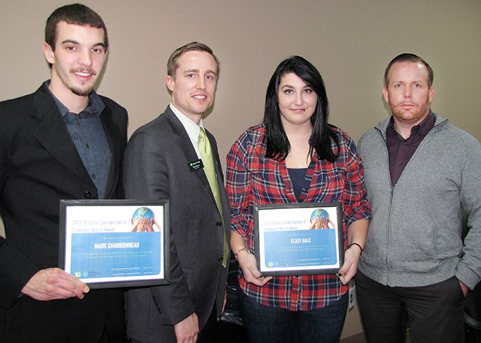 Mark Charbonneau and Elody Gale pose with their TD Youth Contribution to the Community Health Awards. Ben Srokosz TD Bank branch manager, second from left, presented the awards in Chatham Thursday. Also pictured is Darren Wood, youth programs co-ordinator with Chatham-Kent Community Health Centres.
