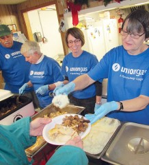 From left, Terry Shadd, Marlene Patterson, Jennifer Broeders and Cathy Konecny were among the Union Gas and regular Campbell AME soup kitchen volunteers on hand Wednesday serving up a Christmas dinner, turkey and all the trimmings.