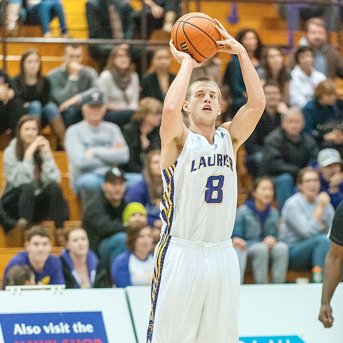 Max Allin goes up for a shot in OUA basketball action. (Photo by Trevor Mahoney)