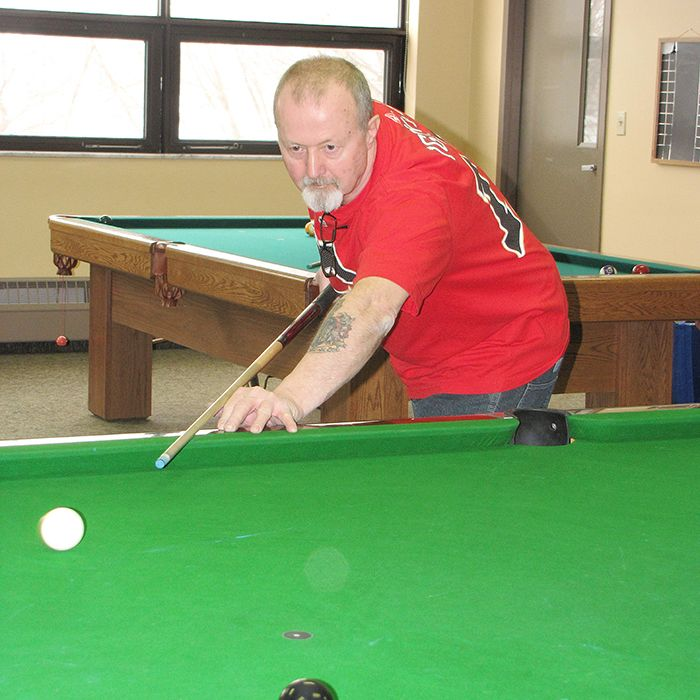 Jim Kelly, 67, watches his shot while enjoying a game of snooker at the Active Lifestyle Centre in Chatham. The billiards room is part of a new addition to the ALC on Merritt Avenue.
