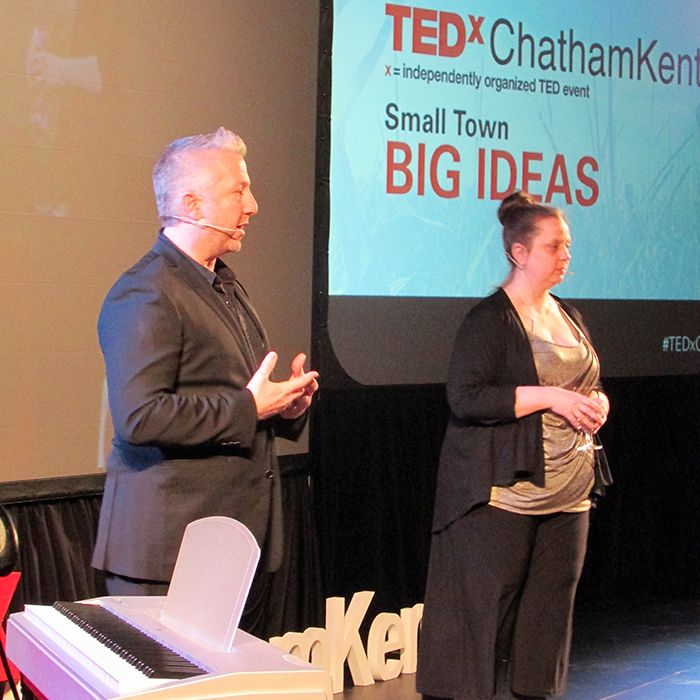 Brother and sister John and Andrea Lyons speak at the opening of TEDx Chatham-Kent.