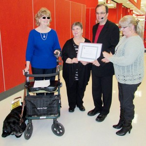 From left, Chatham-Kent Accessibility Advisory Committee member Mickey Puddicomb, Michelle Schryer, committee chairman Ralph Roels and Chatham Coun. Marjorie Crew.