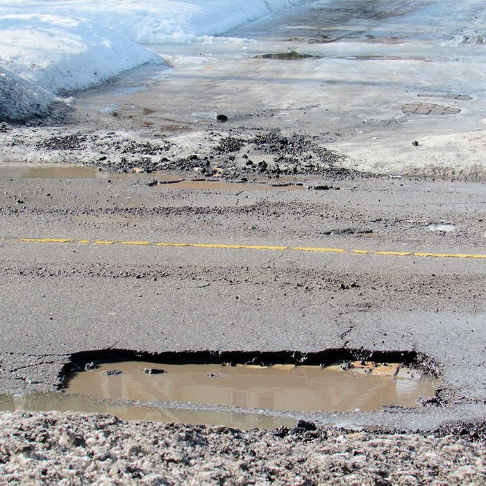 Potholes on Victoria Avenue were so deep in spots, they exposed the underlying brick from days gone by.