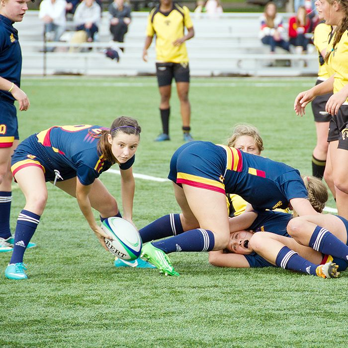 Sydnee Nolan pulls the ball free from a small ruck and prepares to pass to a Queen's University Gaels teammate in rugby play. (Photo by Jason Scourse)