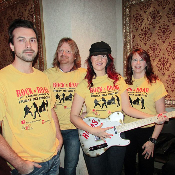 From left, Dave Richie, Mat Drew, Melaina Craievich and Deb Owen show off a custom painted guitar that will be auctioned off on eBay in the near future. Proceeds from the auction will support Rock 'N' Roar for Sophia.