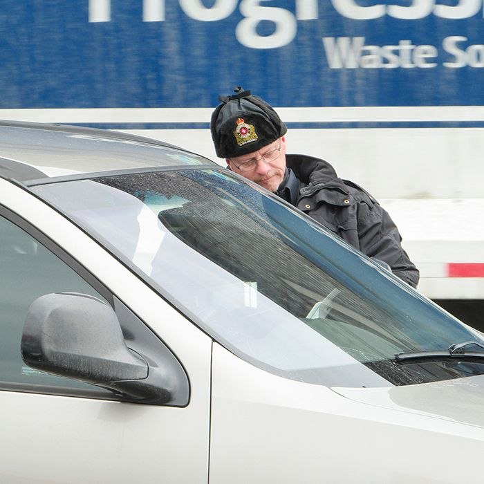 Const. Scott Renders talks to a driver before pulling the person over during today's safety blitz at the corner of Grand Avenue and St. Clair Street in Chatham.