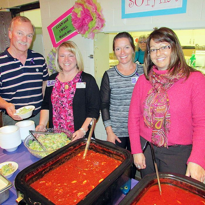 Doug Swant, left, is served a full course spaghetti dinner by Meadow Park Long Term Care Home staff Lydia Swant, co-director of care Michelle Johnson and director of care Susan Vanek.