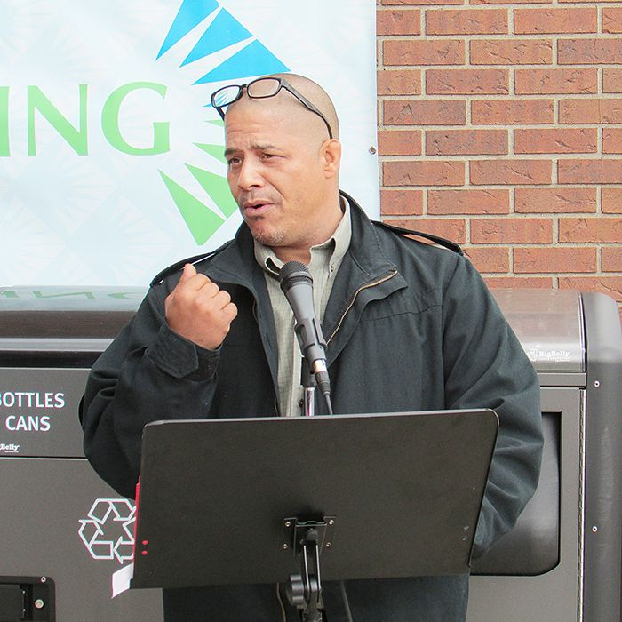 Chris Redding, manager of Swiss Chalet in Chatham, speaks to the crowd outside the Civic Centre in Chatham May 1. Swiss Chalet was honoured at the kickoff to Community Living Month with the Joyce M. Carr Champion Award, given annually to local businesses that support employment of Community Living clients.