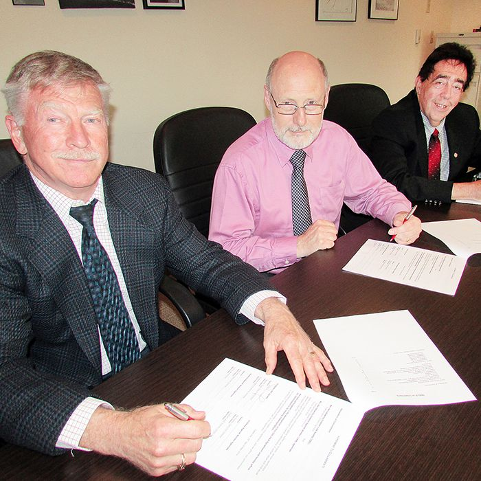 Executive directors Stephen Doig from Children's Services, Brad Davis from Family Service Kent and Hal Bushey from the Women Centre met to sign a collaborative agreement that will make getting help when in an abusive situation easier and more co-ordinated for women in Chatham-Kent.