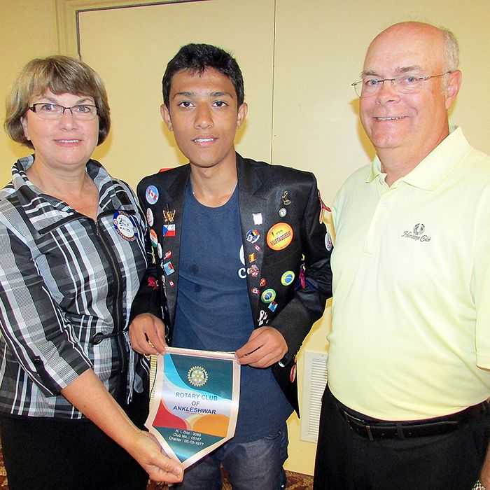 Rotary Club of Chatham host parents Brett and Lynn Smith are proud of Rotary International exchange student Musa Shaikh from India, who gave a speech on his experience in Canada at a Rotary luncheon June 11.