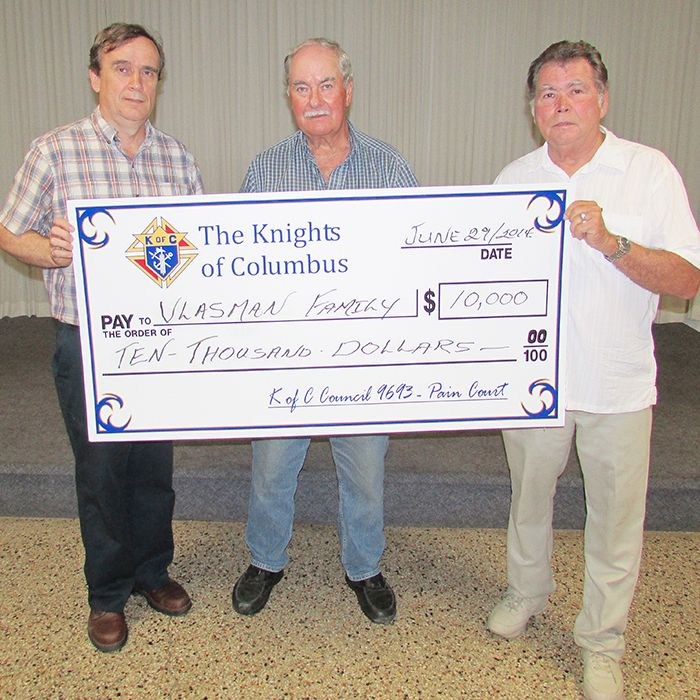 The Vlasman family was unable to be on hand to accept their cheque from the dinner, but Yvon Sterling, grand knight of Knights of Columbus council 9693, left; Bob Branquet, dinner organizer; and Norb King, right, chairman of the Wild Game Supper committee with the Knights of Columbus will ensure they receive their funds.
