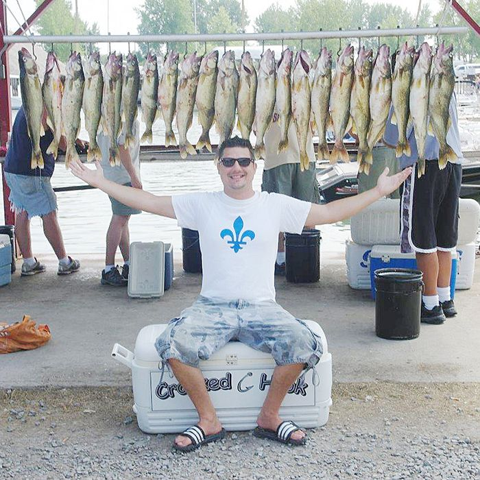 The smile and the fish behind him say it all for this member of a Crooked Hook Charters excursion.