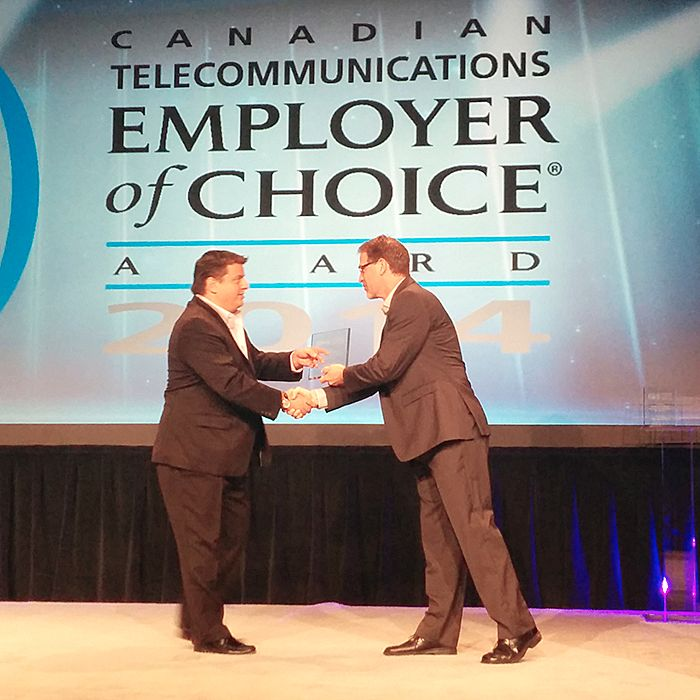 Marc Gaudrault, CEO of TekSavvy, accepts the 2014 Telecom Employer of Choice Award at the Canadian Telecom Summit in Toronto.
