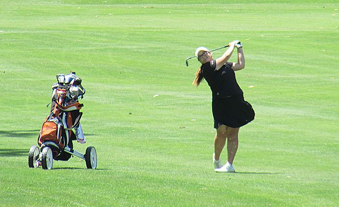 Alyssa Getty, of Kingsville Golf & Country Club, sends her approach shot onto the 18th green Tuesday at Maple City Country Club just east of Chatham. Getty fired a new junior girls' course record 68 on the day, while taking part in the Ontario Junior Girls' Championships. The event runs until Friday.