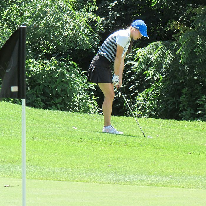 Danielle Sawyer of Shelter Valley Pines Golf Club prepares to chip onto the green in Tuesday action at Maple City Country Club. Sawyer is taking part in the Ontario Junior Girls' Championships.