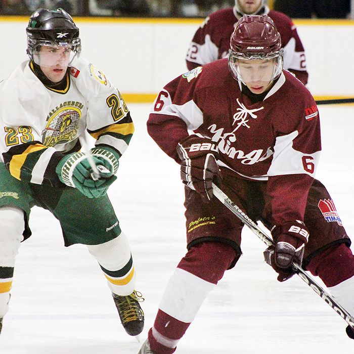 Dede Cato, right, of with the Dresden Kings, is pursued by a Wallaceburg Laker in Jr. C hockey play. (Photo by Jocelyn McLaughlin)