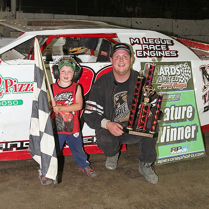 Sport Stocks mid-season champion Eren Vanderiviere and son Cole, pose in front of Eren's ride. (Contributed image)