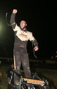 Kyle Patrick pumps his fist as he exits his winning OTS wingless sprint. (James MacDonald, Apex One Photo)