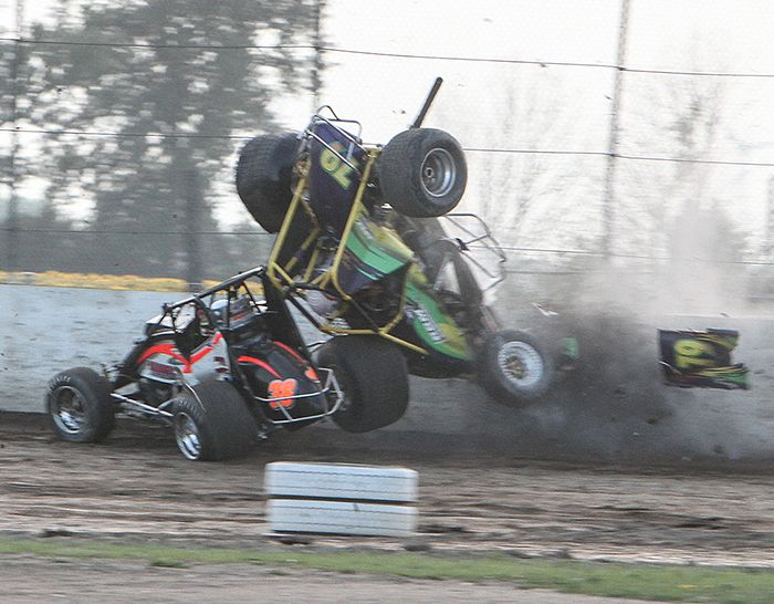 A wild crash in the OTS heat between Chatham's Tyler Hendricks (38, black and orange car) and Newmarket's Dick Mahoney (green, yellow and white No. 79) in the turn. Both drivers had bumps and bruises, but no serious injuries. The cars suffered major damage. (James MacDonald, Apex One Photo)