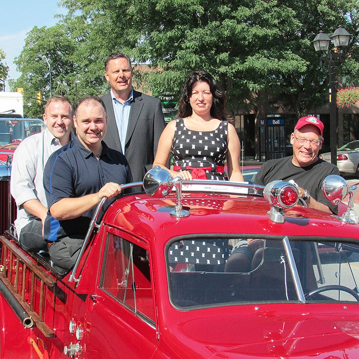 Friends and supporters of Firefest climbed aboard a 1950 Crosley Thursday in preparation of the Sept. 19-21 event.