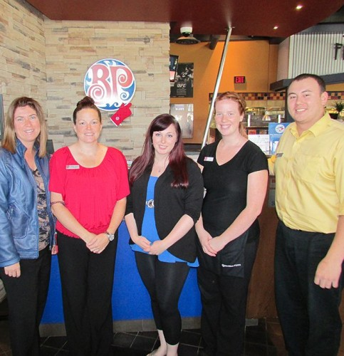 From left, Nathalie Sanson of the Conseil scolaire catholique Providence, Linda Niven of Boston Pizza, Holly Caron of Big Brothers Big Sisters, and Shannon Gow and Wade Gurd of Boston Pizza gather to celebrate the restaurant's recent donation to help expand Big Brothers Big Sisters programs into the francophone community.