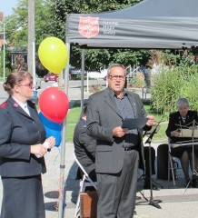 Chatham Coun. Bob Myers speaks to folks who gathered at the Salvation Army's new Raleigh Street facilities Friday, while Capt. Stephanie Watkinson looks on.