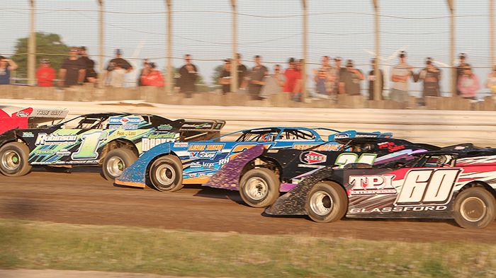 Late Models drivers from bottom of track to the top, Dale Glassford (60), Jim Jones (34), Gregg Haskell (RH21) and Brad Authier (1A) battle it out at South Buxton Raceway. (James MacDonald ApexOne Photos)