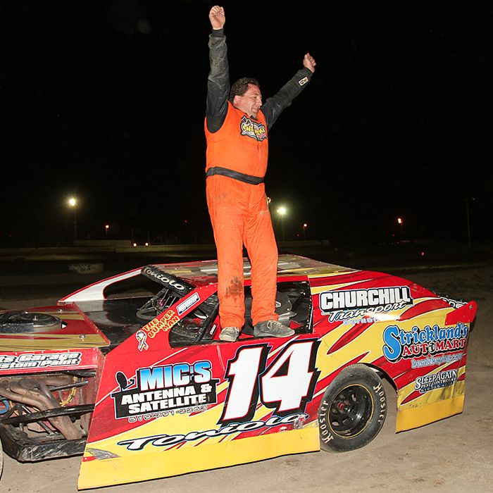 Mario Toniolo is pumped up after his feature win. (James MacDonald ApexOne Photo)