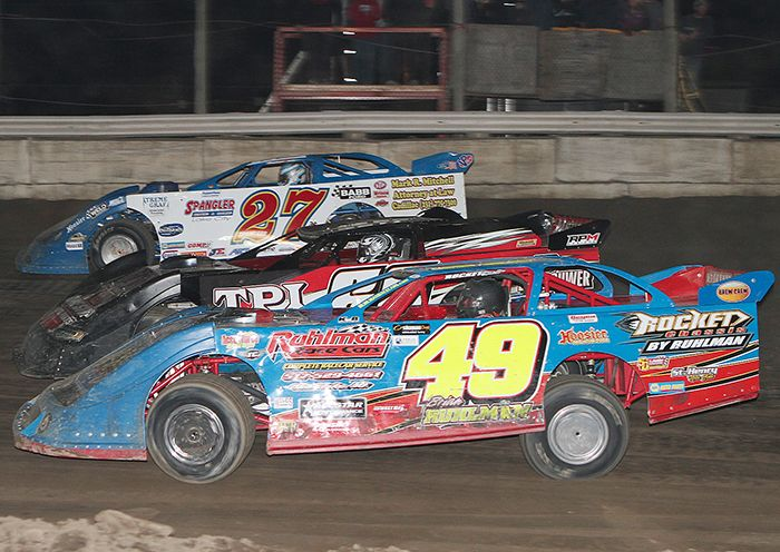 Late Model Shootout is a three-wide battle with eventual winner Eric Spangler (27) and Brian Ruhlman (49) sandwiching Dale Glassford (60). (James MacDonald Photo)